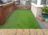 Artifical grass in a small front garden